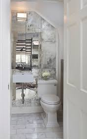 new orleans antique mirror tiles powder room traditional with tile