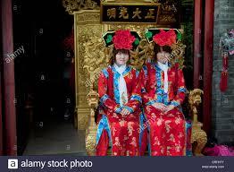 girls sitting in a golden throne have photo taken wearing