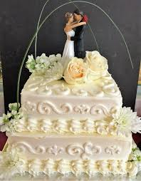 traditional wedding cake with buttercream scroll piping
