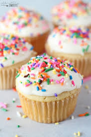 Vanilla Cupcakes With Ice Cream And Rainbow Sprinkles
