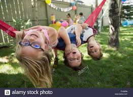 Portrait Upside-down Kids Hammock Backyard Birthday Party Stock ... Backyard Birthday Party Ideas For Kids Exciting Backyard Ideas Domestic Fashionista Summer Birthday Party Best 25 Parties On Pinterest Girl 1 Year Backyards Mesmerizing Decorations Photo Appealing Catholic All How We Throw A Movie Night Pear Tree Blog Elegant Games Adults Architecturenice Parties On Water