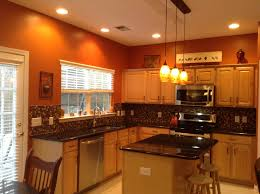 burnt orange kitchen with new lighting house