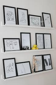 unsere gallery wall mit selbst gemachten lineart pri