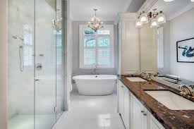 Example Of A Classic White Tile Bathroom Design In Tampa With An Undermount Sink Raised
