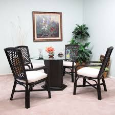 Black Rattan Dining Room Chair With Arms And Back Added By Round Glass Table On