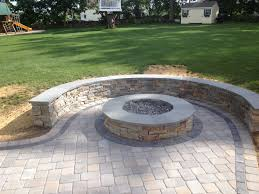 Natural Stone Sitting Wall With Bluestone Cap Surrounds A Fire Pit ... Backyard Ideas For Kids Kidfriendly Landscaping Guide Install Pavers Installation By Decorative Landscapes Stone Paver Patio With Garden Cut Out Hardscapes Pinterest Concrete And Paver Installation In Olympia Tacoma Puget Fresh Laying Patio On Grass 19399 How To Lay A Brick Howtos Diy Design Building A With Diy Molds On Sand Or Gravel Paving Dazndi Flagstone Pavers Design For Outdoor Flooring Ideas Flagstone Paverscantonplymounorthvilleann Arborpatios Nantucket Tioonapallet 10 Ft X Tan