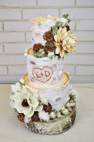 Love The Initials Carved Into Cake Rustic Birch Log Wedding With Dried Flowers From Artisan Company