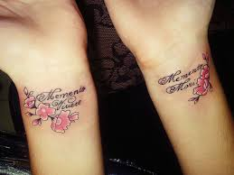 Tattoo On Her Wrists Of The Girl