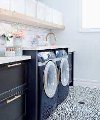 white and black laundry room with black and white cement