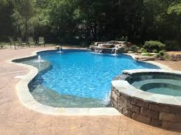 Npt Pool Tile And Stone by 9 Popular Pool Surfaces For Gunite Concrete Fiberglass U0026 Vinyl