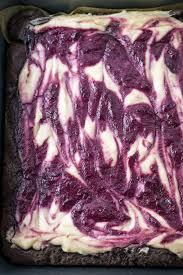 Vanilla infused fresh cherries swirled with cashew cream makes the perfect vegan berry cheesecake topping