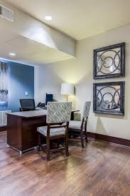 Apartment Community Leasing Office With Mirrored Wall Art Guest Seating And A Blue Accent