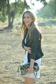 Blogger Emily Schuman Poses In One Of Her Trademark Outfits