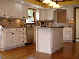 White Kitchen Cabinets Ideas With Brown Floor And Hanging Lamps