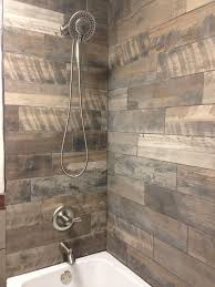 rustic shower with the wood looking porcelain tiles on nobby