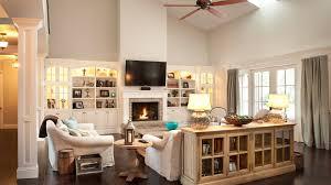 open two story family room with white built in bookshelves brick