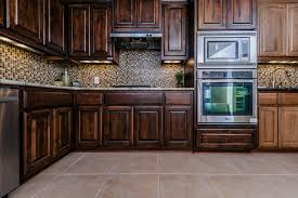 kitchen tile ideas with oak cabinets in sightly travertine tile