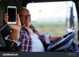 Senior Truck Driver Showing Mobile Phone Stock Photo (100% Legal ... Universal Car Truck Phone Accsories Sticky Drawer Storage Telit Roadstar 35g Cartruck Search Brands Mobile Senior Driver Working On A Stock Photo Picture Truck On The Mobile Phone Screen With Map Vector Kalen Connected To A Cell Through Usb Cable Outline Of Awesome Peterbilt Trucks Fashion Cell Cases For Iphone X 4 4s Eat Sleep Cool Wallet Run Hard Get Paid Peidan White 9 Protective Cover Case For Samsung Galaxy Led Advertising With Japanese Isuzu C Szhen Permanent Van Dashboard Console Ipad Mini Mount Holder Classic Ford Emblem Vertical Stripe Fcg Black Grays Green Tans