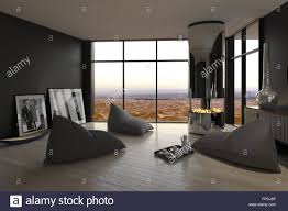 Informal Living Room Interior With Bean Bags For Seating Arranged Around An Open Chimney On A Wooden Parquet Floor Grey Walls And Large View Window