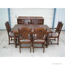 This Great Eight Piece Antique Oak Refractory Dining Tablechairs