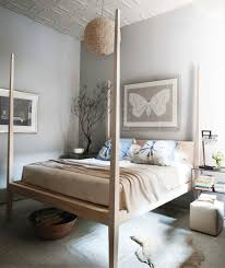 Enchanting Teak Wooden High Poster Bed With Butterfly Artwork Pictures Hang On Grey Wall Rustic Bedroom Color Schemes