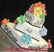 Black and white square custom fondant wedding cake with rainbow flowers