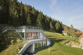 100 Jds Architects Swooping French Home Is Partially Built Into A Hillside Curbed