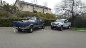Two Trucks Outside Of The Movie Theater Take Up 5 Compact Spots ...