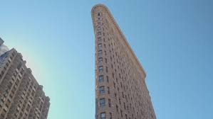 CLOSE UP Famous Flatiron Iron Shaped Building With Limestone And Glazed Terracotta Facade In New York City Parallel To Fifth Avenue Broadway