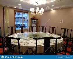 Round Dining Table In A Chinese Restaurant In China ... Amazoncom Cjh Nordic Chinese Ding Chair Backrest 66in Rosewood Dragon Motif Table With 8 Chairs China For Room Arms And Leather Serene And Practical 40 Asian Style Rooms Whosale Pool Fniture Sun Lounger Outdoor Chinese Ding Table Lazy Susan Macau Lifestyle Modernistic Hotel Luxury Wedding Photos Rosewood Set Firstframe Pure Solid Wood Bone Fork