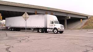 100 Truck Jumps Man On Moving Semi From Overpass
