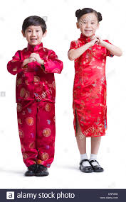 cute children in traditional clothing celebrating chinese new year