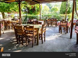 Chairs Tables Typical Image & Photo (Free Trial) | Bigstock Tables Old Barrels Stock Photo Image Of Harvesting Outdoor Chairs Typical Outdoor Greek Tavern Stock Photo Edit Athens Greece Empty And At Pub Ding Table Bar Room White Height Sets High Betty 3piece Rustic Brown Set Glass Black Kitchen Small Appealing Swivel Awesome Modern Counter Chair Best Design Restaurant Red Checkered Tisdecke Plaka District Tavern Image Crete Greece Food Orange Wooden Chairs And Tables With Purple Tablecloths In