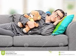 young man in pajamas sleeping on sofa at home stock image image