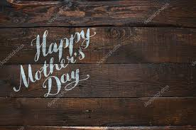 Happy Mothers Day Lettering Calligraphy On Dark Rustic Barn Wood Holiday Background Space For Text