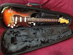 Charitybuzz Take Home A FenderR StratocasterR Guitar Signed By John M