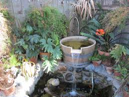 Barrel Fountain And Pond   Courtyard   Pinterest   Garden Oasis ... Frog Lodge Gabe Feathers Mcgee The Whisper Folks How To Create A Wildlife Pond Hgtv Building Ogfriendly Build On Budget Youtube Backyard Home Landscapings Ideas Garden Diy Project Full Video To Make Chickadee Habitat Design And Build Wildlife Pond Saga For Frogs Part 5 Outdoor Patio Cute Round Koi Mixed With