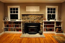 Living Room With Fireplace And Bookshelves by Fireplace Bookshelves With Wood Storage Hudson Cabinet Making