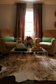 Embellish Your Home With Awesome Cowhide Rugs Witching Rug In Impressive Living Room