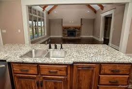 4 Tags Rustic Kitchen With New Caledonia Granite Countertop Arizona Eastland Cabinets