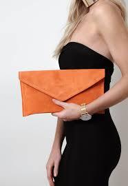 pretty lavish u2013 suede envelope clutch bag orange