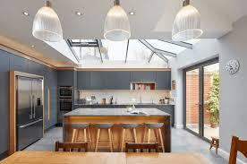 White Cabinets Dark Grey Countertops by White Cabinets Grey Kitchen Island Ellajanegoeppinger Com