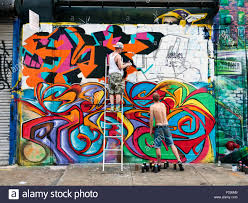 Famous Street Mural Artists by People Painting Mural At 5 Pointz Long Island City Queens New