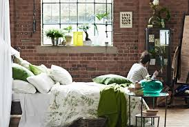 View Of Bedroom With Bed Piled Fluffy Pillows Botanical Themed Linen A