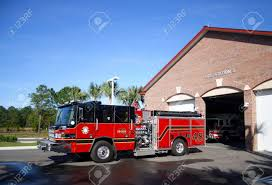 100 Black Fire Truck Red And Engine Parked In Front Of Station Number