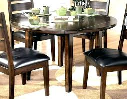 Round Kitchen Table With Leaf Extension Dining