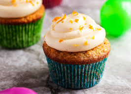 Moist Carrot Cake Cupcakes with Cream Cheese Frosting Grinding up the carrots packs more carrots