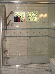 blue glass and white subway tile s tub shower traditional