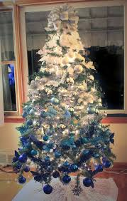 A Christmas Tree With Ombre Decor From White To Electric Blue Looks Very Bold