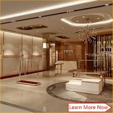 China Modern Fashion Wooden Stainless Steel Used Retail Clothing Displays Store Fixtures With Lighting Supplier